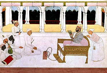 Raja Balwant Singh of Jasrota looking at a painting