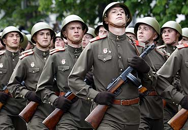 Soldiers in historical uniforms march during a military parade in the Black Sea port of Sevastopol