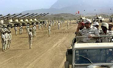 Saudi Prince Khaled bin Sultan bin Abdul-Aziz, returns a salute to Saudi soldiers