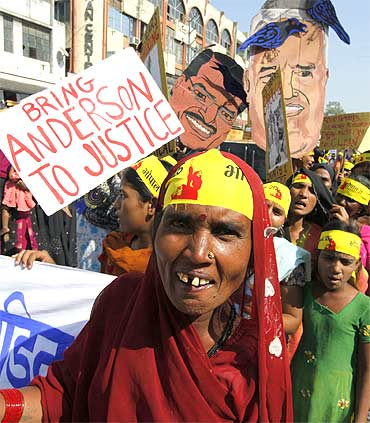 Activists attend a demonstration to mark the 25th anniversary of the Bhopal gas disaster