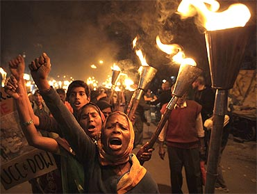 Activists shout slogans during a torch rally to mark the 25th anniversary of the Bhopal gas disaster