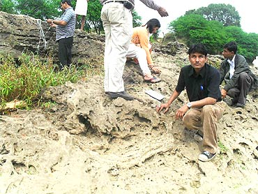 Scientists inspect the site where the fossils were found