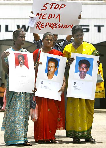 Demonstrators hold pictures of relatives and friends who went missing during Sri Lanka's war with the LTTEin Colombo on September 9, 2009
