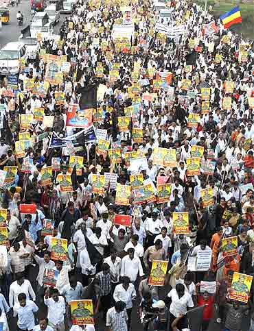 Protesters hold portraits of slain LTTE leader Prabhakaran at a rally against Sri Lanka's President Mahinda Rajapaksa in Chennai on May 21, 2009