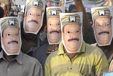Protesters wear masks of slain LTTE chief Vellupillai Prabhakaran at a rally against Sri Lanka's President Mahinda Rajapaksa in Chennai on May 28, 2009