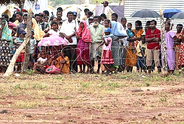 Refugees from the Settikulam Internally Displaced People camp in northern Sri Lanka wait to meet their relatives August 15, 2009