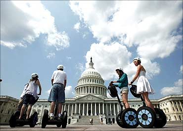 A group of tourists take a guided tour of Capitol Hill in Washington