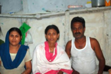 Mohammed Habeeb (right) with his wife and daughter at their tenement in JP Nagar, Bhopal