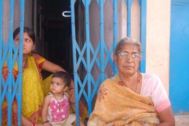 Kusumbai (right) sits outside her house in Bhopal