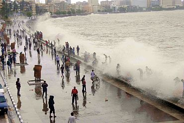 People enjoying the waves at Nariman Point