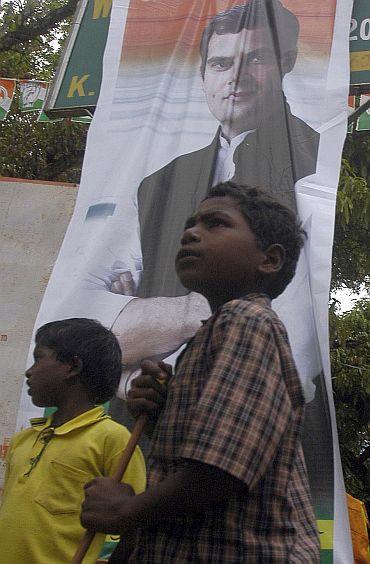 Children pose with a banner of Rahul Gandhi in Karnataka
