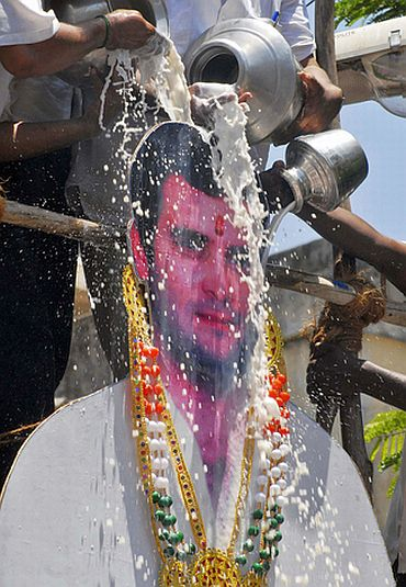 Rahul's supporters pour milk over a life-size cut-out