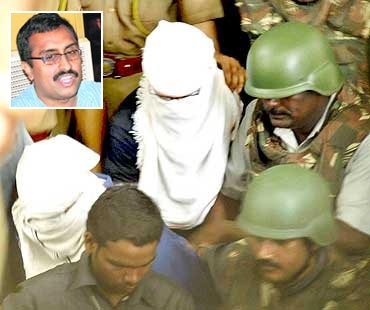 Devender Gupta and Lokesh Sharma, hooded, being produced in a Hyderabad court. Inset: Ram Madhav