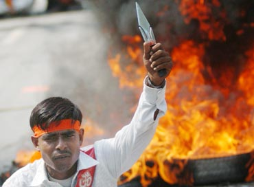 A Bajrang Dal activist attends a protest rally in Lucknow
