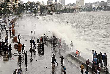 A violent sea tries to break the barrier at Marine Drive.
