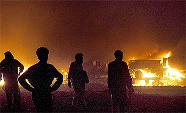 A convoy, which was carrying supplies to NATO forces in Afghanistan, was set ablaze near Islamabad