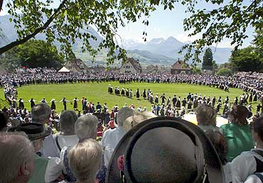 Participants dance at a traditional costume festival in Schwyz