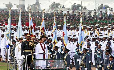 Sri Lanka's President Mahinda Rajapaksa inspects a parade in Colombo