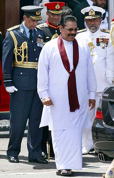 Sri Lanka's President Mahinda Rajapaksa (front), commander of the air force Air Vice Marshal Roshan Gunathilake (L) and army commander Lieutenant General Jagath Jayasuriya (2nd L), Commander of the Navy Vice Admiral Thisara Samarasinghe at the parade
