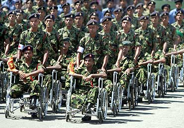 Disabled army soldiers take part in the parade in Colombo