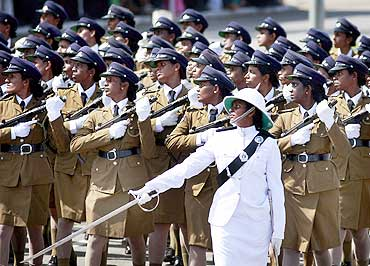 Women police officers march at a war victory ceremony in Colombo