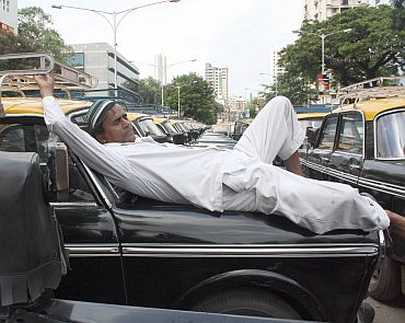 A cab driver takes a nap