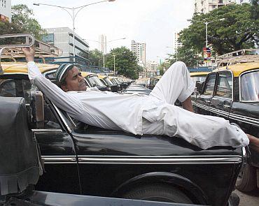 A cab driver takes a nap