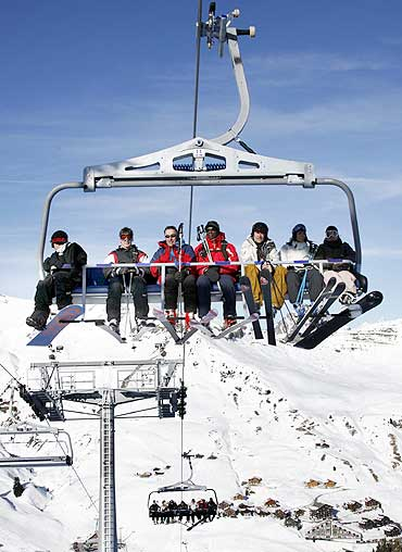 Skiers on a chairlift at Les Crosets, 120 kilometres east of Geneva, Switzerland
