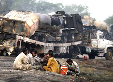 Gunmen attacked trucks carrying supplies for Western forces in Afghanistan near Islamabad on June 9