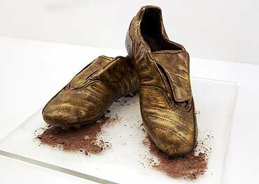 A pair of chocolate soccer boots