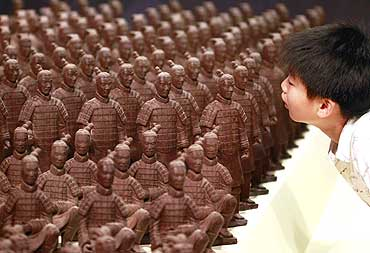 A boy looks at chocolate terracotta warriors