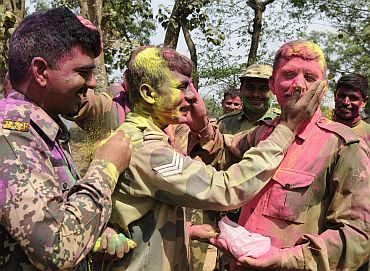 Border Security Force soldiers celebrate Holi