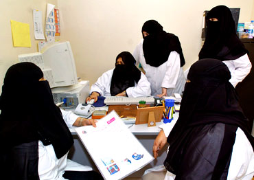 Veiled women doctors work at a hospital in Riyadh, Saudi Arabia