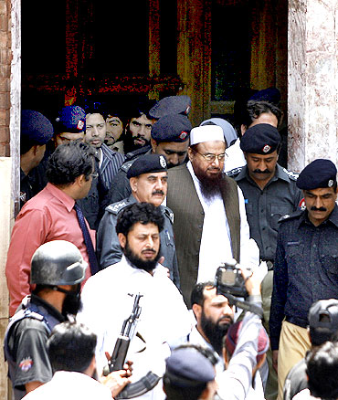 Hafiz Saeed, chief of the banned Jamaat-ud-Dawa and LeT founder, outside a Lahore court.