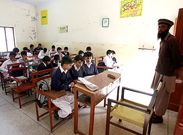 Students at a school at the Jamaat-ud-Dawa charity's headquarters, in Muridke near Lahore