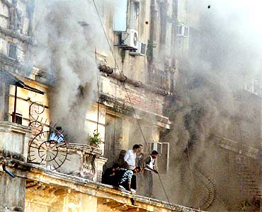 People rushed out of their windows and stood on the ledge of the burning building