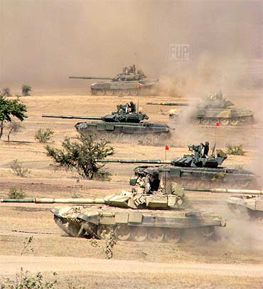 Indian battle tanks in action during an exercise