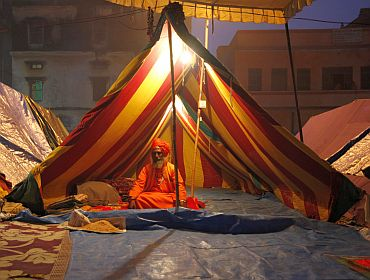 A sadhu in his tent near the banks of the Ganga