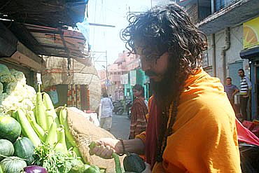 An ascetic shops for vegetables in a market at Kankhal, Haridwar