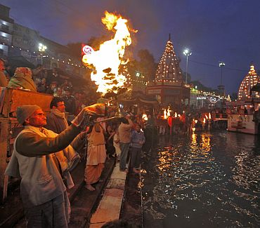 A priest performs the evening aarti on the banks of the Ganga