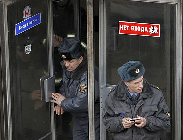 Interior Ministry officers walk out from Park Kultury metro station in Moscow