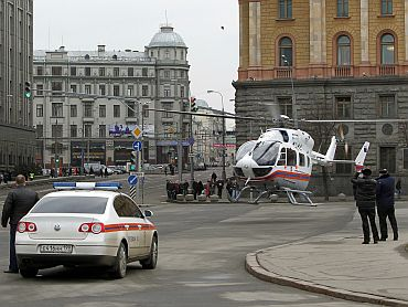 A helicopter of the Russian Emergencies Ministry prepares to ascend near the Lubyanka metro station in Moscow