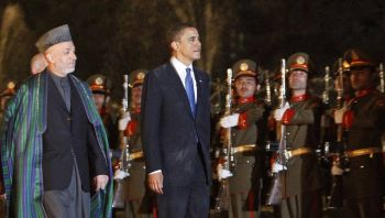 US President Barack Obama inspects a guard of honor with Afghan President Karzai at the Presidential Palace in Kabul on Sunday