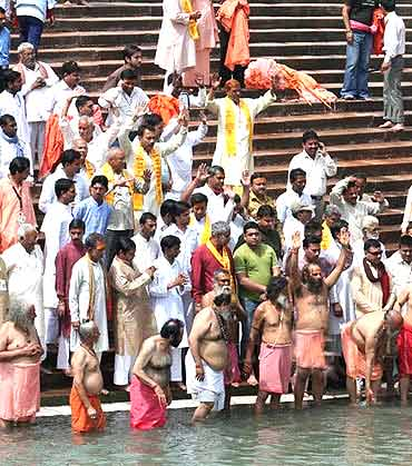 Sadhus belonging to one of the akhadas takes a dip in the Ganga