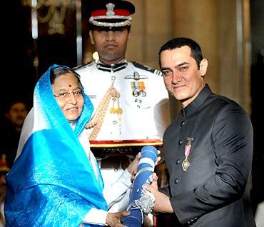 President presenting Padma Bhushan Bollywood star Aamir Khan