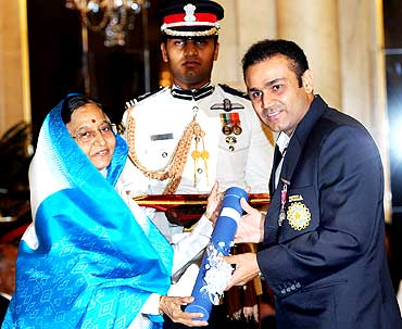 President presenting Padma Shri Award to cricket icon Virender Sehwag