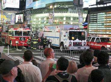 Curious onlookers watch the police in action at Times Square