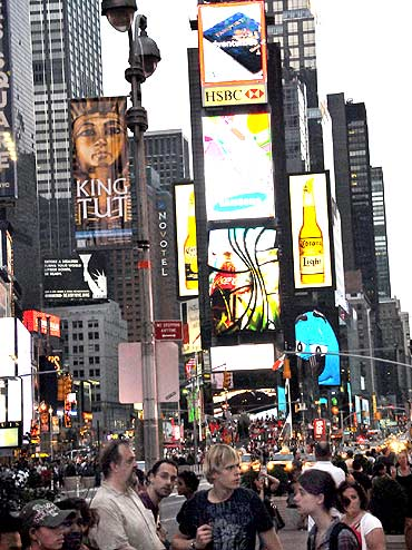 Times Square is buzzing again a day after a misfired bomb attack