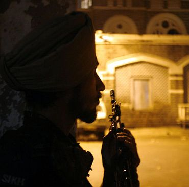 A paramilitary trooper keeps watch during the 26/11 attacks