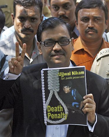 Special Prosecutor Ujjwal Nikam gestures as he speaks to the media outside Arthur Road Jail, after Mohammad Ajmal Kasab -- the lone surviving gunman of the 2008 Mumbai attacks -- was sentenced to death